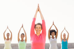 Smiling sporty woman doing yoga in yoga class Royalty Free Stock Photo