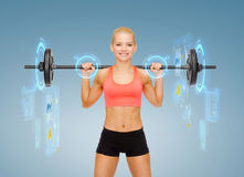 Smiling sporty woman exercising with barbell Royalty Free Stock Image