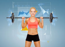 Smiling sporty woman exercising with barbell Royalty Free Stock Photo