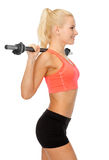 Smiling sporty woman exercising with barbell Royalty Free Stock Images