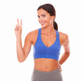 Smiling sporty woman happily celebrating victory Royalty Free Stock Image