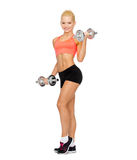 Smiling sporty woman with heavy steel dumbbells Stock Images