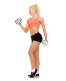 Smiling sporty woman with heavy steel dumbbells Royalty Free Stock Photo