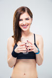 Smiling sporty woman holding glass of water Royalty Free Stock Image