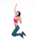 Smiling sporty woman jumping Royalty Free Stock Photos