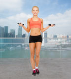 Smiling sporty woman jumping with skipping rope Royalty Free Stock Photography