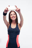 Smiling sporty woman making selfie photo Royalty Free Stock Images