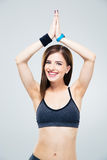 Smiling sporty woman making yoga exercises Royalty Free Stock Image