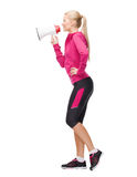 Smiling sporty woman with megaphone Royalty Free Stock Image