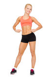 Smiling sporty woman pointing at her six pack Royalty Free Stock Image