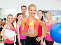 Smiling sporty woman with protein shake bottle Royalty Free Stock Photos