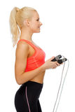 Smiling sporty woman with with skipping rope Stock Photography