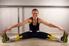 Sporty smiling woman stretching Stock Images