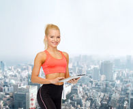 Smiling sporty woman with tablet pc computer Royalty Free Stock Photo