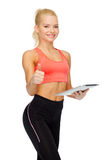 Smiling sporty woman with tablet pc computer Royalty Free Stock Photos