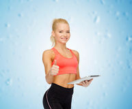 Smiling sporty woman with tablet pc computer Stock Photography