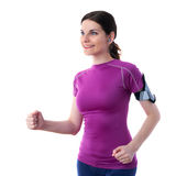 Smiling sporty woman in violet T-short over white isolated background Royalty Free Stock Photos