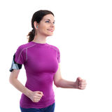 Smiling sporty woman in violet T-short over white isolated background Royalty Free Stock Photo