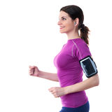 Smiling sporty woman in violet T-short over white isolated background Stock Image