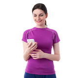 Smiling sporty woman in violet T-short over white isolated background Royalty Free Stock Images