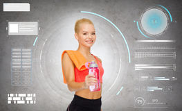Smiling sporty woman with water bottle and towel Royalty Free Stock Photos