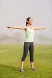 Smiling sporty woman working out Stock Photos