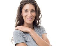 Smiling sporty woman. Smiling sporty young woman posing on white background, wellbeing and natural look concept Royalty Free Stock Photography