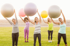 Smiling sporty women working out with exercise balls Royalty Free Stock Photos