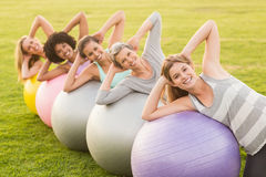 Smiling sporty women working out with exercise balls. Portrait of smiling sporty women working out with exercise balls in parkland Royalty Free Stock Image