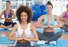 Smiling sporty young people in Namaste position Royalty Free Stock Photography