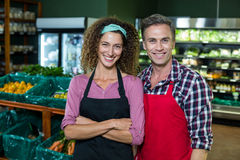 Smiling staffs standing together with arms crossed in organic section Royalty Free Stock Image