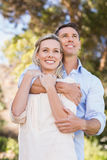 Smiling standing couple embracing and enjoying the view Stock Photos