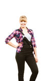 Smiling standing woman wearing dungarees and shirt Stock Photography