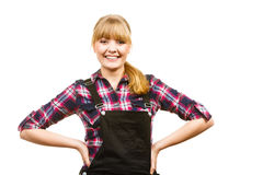 Smiling standing woman wearing dungarees and shirt Stock Image