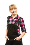 Smiling standing woman wearing dungarees and shirt Royalty Free Stock Photo