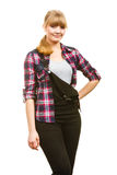 Smiling standing woman wearing dungarees and shirt Stock Photo