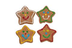Smiling star shaped Christmas gingerbread cookies Royalty Free Stock Images