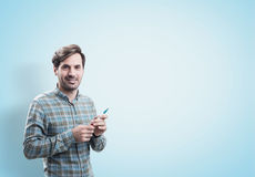 Smiling startup founder with a marker, blue wall Stock Image