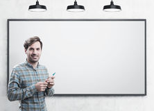 Smiling startup founder with a marker, whiteboard Stock Photos