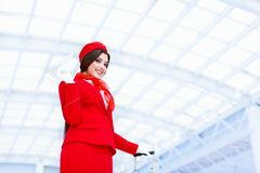 Smiling stewardess in a form Stock Photo