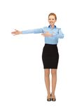 Smiling stewardess showing direction Royalty Free Stock Photography