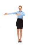 Smiling stewardess showing direction Royalty Free Stock Photo