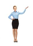 Smiling stewardess showing direction Royalty Free Stock Photos