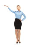 Smiling stewardess showing direction Stock Photo