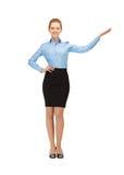 Smiling stewardess showing direction stock photos