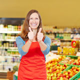 Smiling store manager holding Royalty Free Stock Image