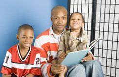 Smiling story readers. Happy family reading a story book Royalty Free Stock Photo