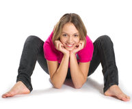 Smiling stretching girl. Smiling stretching teenage girl on white background Stock Photography