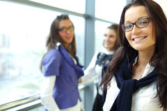 Smiling student. Student meeting smiley girl face on foreground Stock Photos