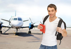 Smiling student with backpack and book at airport Royalty Free Stock Images